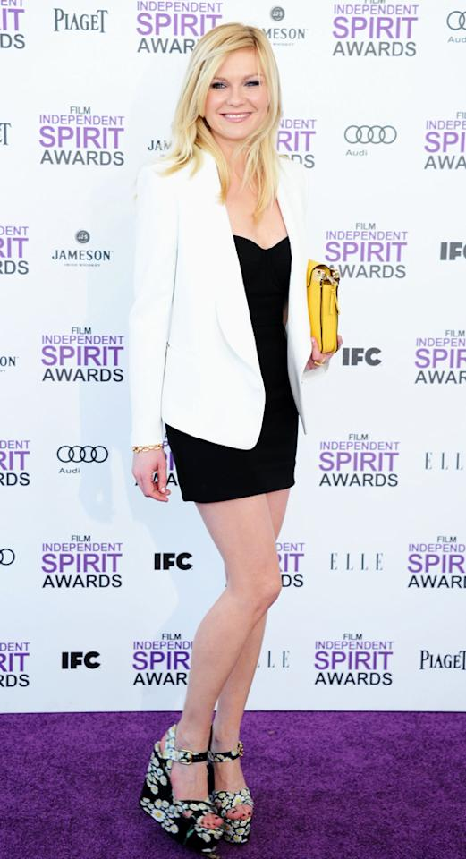 """Kirsten Dunst -- who was robbed of a nomination for her work in """"Melancholia"""" -- looked better than ever in a crisp white blazer and LBD. Her accessories included a trendy mustard-colored clutch and flowered wedges."""