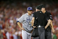 Milwaukee Brewers manager Craig Counsell speaks to officials during the eighth inning of a National League wild-card baseball game against the Washington Nationals at Nationals Park, Tuesday, Oct. 1, 2019, in Washington. (AP Photo/Andrew Harnik)