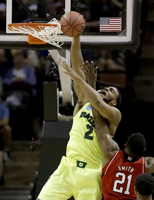 Baylor's Rico Gathers (2) is fouled by Nebraska's Leslee Smith (21) during the first half of a second-round game in the NCAA college basketball tournament Friday, March 21, 2014, in San Antonio. (AP Photo/David J. Phillip)