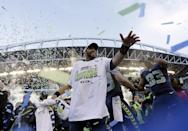 Seattle Seahawks' Russell Wilson celebrates after overtime of the NFL football NFC Championship game against the Green Bay Packers Sunday, Jan. 18, 2015, in Seattle. The Seahawks won 28-22 to advance to Super Bowl XLIX. (AP Photo/David J. Phillip)