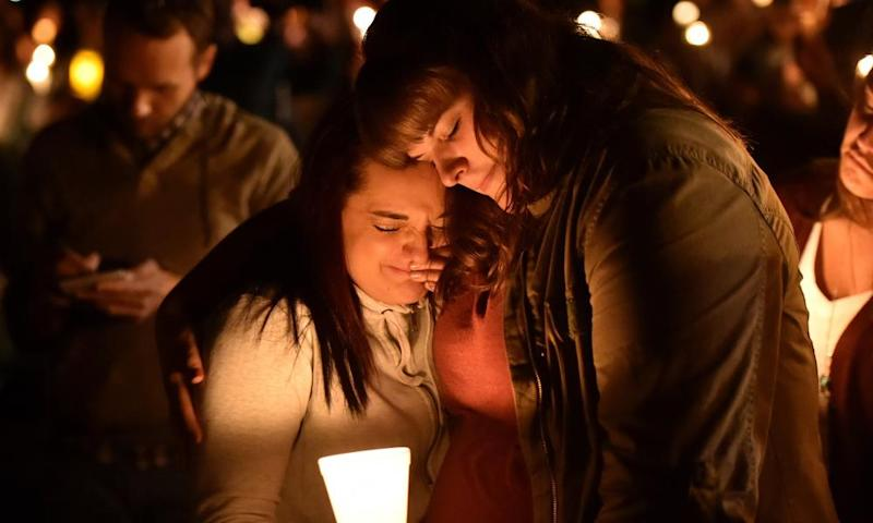 Mourners react during a vigil in Roseburg, Oregon, in 2015, for 10 people killed and seven others wounded in a shooting at a community college.