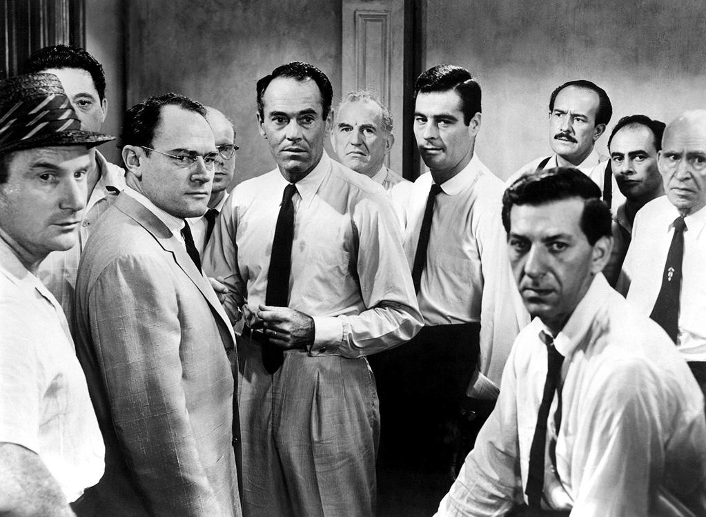 """<a href=""""http://movies.yahoo.com/movie/1800340284/info"""">12 Angry Men</a> (1957): Precise and riveting in its depiction of the heart of man, the difficulty of compromise and the possibility of forgiveness. Sidney Lumet's film -- his first feature -- is based on a Reginald Rose teleplay, and with the action mainly occurring inside a jury deliberation room, it does give you the intense, even claustrophobic feeling of having front-row seats for a powerful play. It's all about the dialogue, all about the performances, with a stellar cast led by Henry Fonda, Martin Balsam, Jack Warden and Jack Klugman. We never know whether the defendant in this murder trial is truly guilty; what matters are the prejudices and life experiences the jurors bring to the debate."""