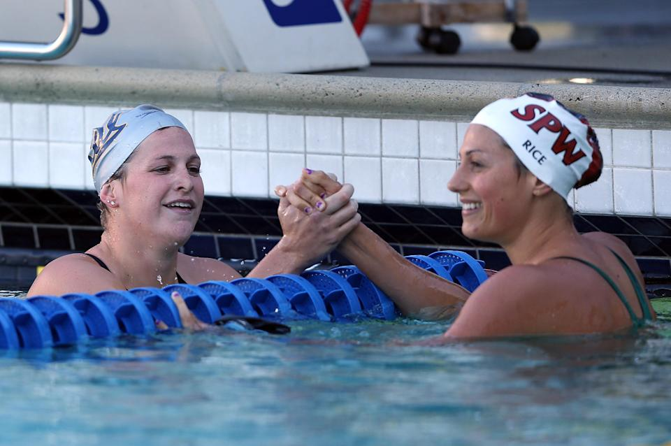 Caitlin Leverenz (L) shakes hands with Stephanie Rice of Australia after the women's 200 meter IM final during day 4 of the Santa Clara International Grand Prix at George F. Haines International Swim Center on June 3, 2012 in Santa Clara, California. (Photo by Ezra Shaw/Getty Images)