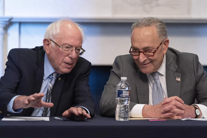 Senate Majority Leader Chuck Schumer of N.Y., right, sits next to Sen. Bernie Sanders, I-Vt., during a meeting with Senate Democrats on the Budget Committee, Wednesday, June 16, 2021, on Capitol Hill in Washington. (AP Photo/Jacquelyn Martin)