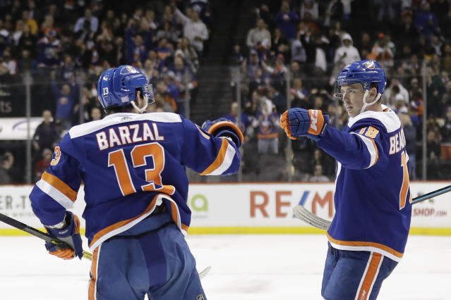 New York Islanders' Anthony Beauvillier, right, celebrates with Josh Bailey after scoring during the second period of an NHL hockey game against the Pittsburgh Penguins Thursday, Nov. 21, 2019, in New York. (AP Photo/Frank Franklin II)