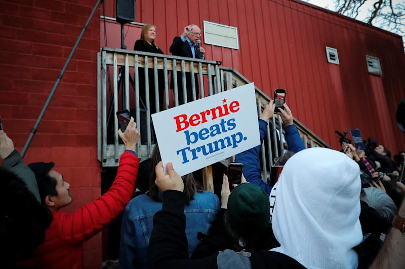 Sen. Bernie Sanders speaks to supporters outside a campaign Super Bowl watch party in Des Moines, Iowa, on February 2, 2020. (Mike Segar/Reuters)
