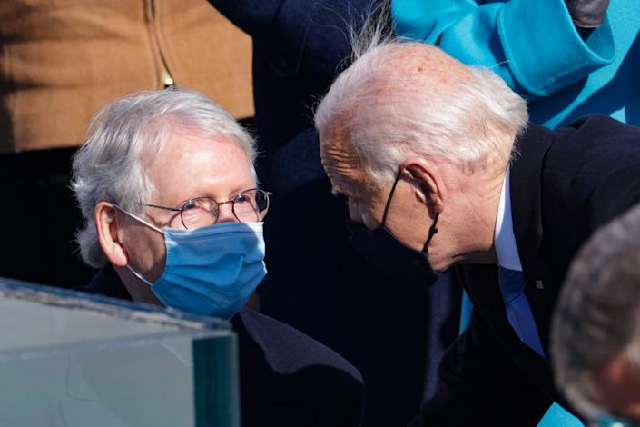 WASHINGTON, DC - JANUARY 20: U.S. President Joe Biden speaks to Senate Majority Leader Mitch McConnell (R-KY) during his inauguration on the West Front of the U.S. Capitol on January 20, 2021 in Washington, DC.  During today's inauguration ceremony Joe Biden becomes the 46th president of the United States. (Photo by Alex Wong/Getty Images)