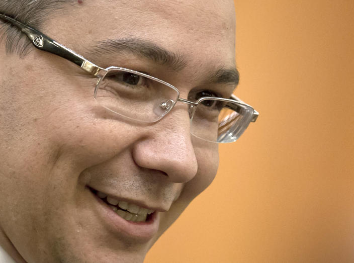 Romanian Premier designate Victor Ponta smiles before a parliament session in Bucharest, Romania, Monday, May 7, 2012. Romanian lawmakers are voting on whether to approve the prime minister designate's left-leaning Cabinet, which is expected to continue a slate of economic reforms. (AP Photo/Vadim Ghirda)