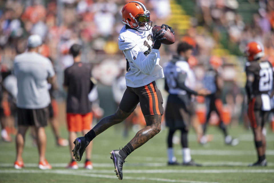 Cleveland Browns receiver Odell Beckham Jr. (13) catches a pass during an NFL football practice in Berea, Ohio, Wednesday, Aug. 4, 2021. (AP Photo/David Dermer)
