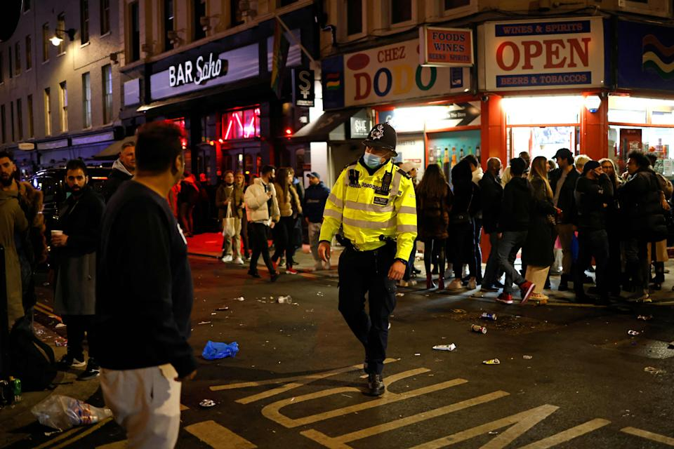 Police patrol the streets in Soho, London on Monday night as pubs reopened after the third lockdown  (AFP via Getty Images)