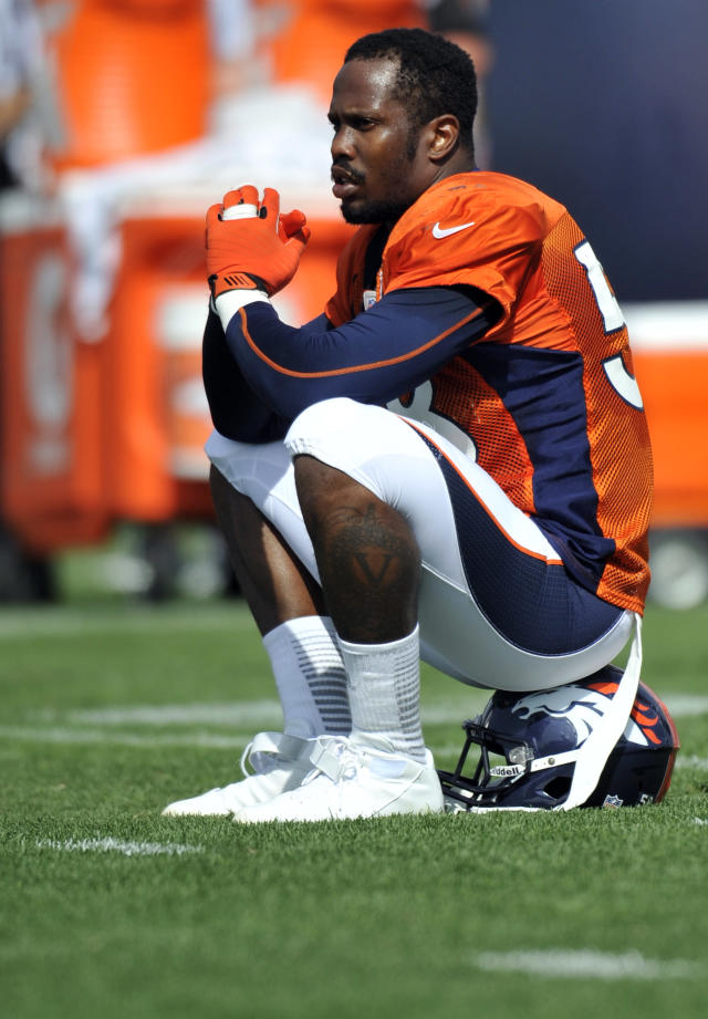 FILE - In this July 27, 2013, file photo, Denver Broncos linebacker Von Miller sits on his helmet during NFL football training camp in Englewood, Colo. A person familiar with the case says Miller, suspended for the first six games of the season under the NFL's substance-abuse policy, was caught trying to manipulate the league's drug-testing system. The person spoke on condition of anonymity Sunday, Sept. 22, 2013, because the league has not announced the details of Miller's violation. (AP Photo/Jack Dempsey, File)