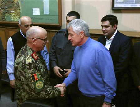 U.S. Secretary of Defense Hagel shakes hands with Afghan General Karimi during a meeting at the ISAF headquarters in Kabul