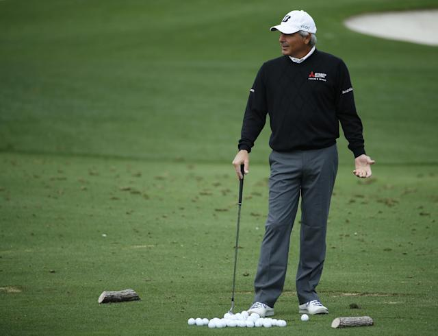 Fred Couples waits to his on the driving range during a practice round for the Masters golf tournament Tuesday, April 8, 2014, in Augusta, Ga. (AP Photo/Matt Slocum)