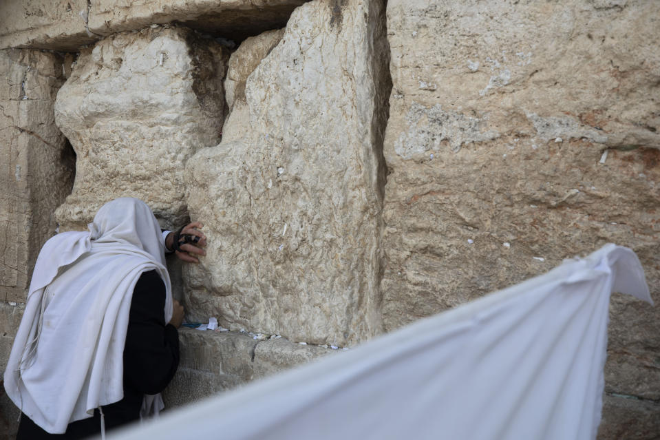 An ultra-Orthodox Jewish man prays ahead of the Jewish new year at the Western Wall, the holiest site where Jews can pray in Jerusalem's old city, Wednesday, Sept. 16, 2020. (AP Photo/Sebastian Scheiner)
