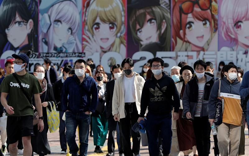 People walk on the Shibuya crossing, amid the coronavirus disease outbreak, in Tokyo, Japan - Reuters