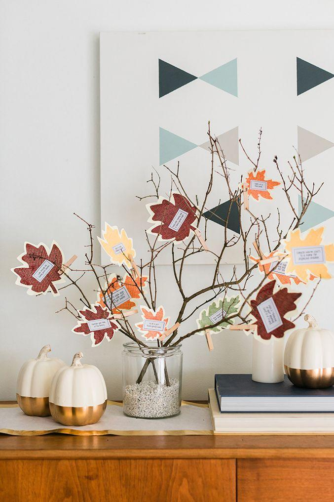 "<p>This elegant seasonal craft is a bit different than your typical thankful tree: Instead of jotting down what you're thankful for, the colorful leaves (which you can DIY and then attach to branches with clothespins) are used as <a href=""https://a.pgtb.me/nB2pXB"" rel=""nofollow noopener"" target=""_blank"" data-ylk=""slk:printable prompts"" class=""link rapid-noclick-resp"">printable prompts</a> for things on your seasonal to-do list — like ""volunteer at a food bank"" or ""invite friends over for Friendsgiving."" </p><p><em><a href=""https://www.dreamgreendiy.com/2018/10/29/diy-thanksgiving-branches-with-printable-prompts/"" rel=""nofollow noopener"" target=""_blank"" data-ylk=""slk:Get the tutorial at Dream Green DIY »"" class=""link rapid-noclick-resp"">Get the tutorial at Dream Green DIY »</a></em></p>"