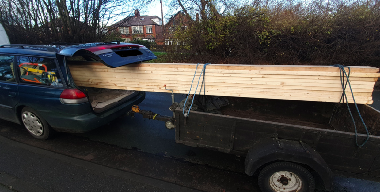The planks of wood were left hanging over the trailer behind the vehicle. (Twitter/@@WYP_LeedsWest)