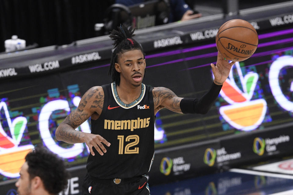 Memphis Grizzlies guard Ja Morant (12) passes during the first half of an NBA basketball game against the Washington Wizards, Tuesday, March 2, 2021, in Washington. (AP Photo/Nick Wass)