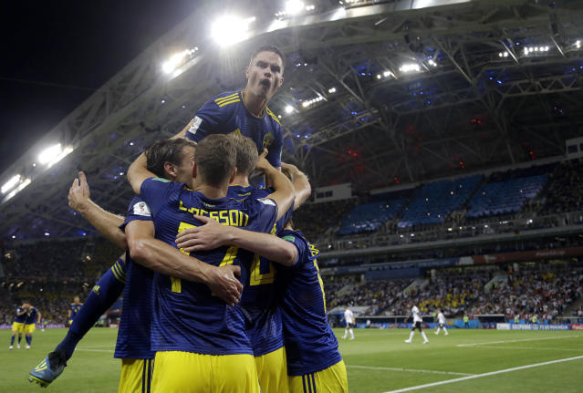 Sweden's Ola Toivonen celebrates with teammates after scoring his side's opening goal during the group F match between Germany and Sweden at the 2018 soccer World Cup in the Fisht Stadium in Sochi, Russia, Saturday, June 23, 2018. (AP Photo/Thanassis Stavrakis)