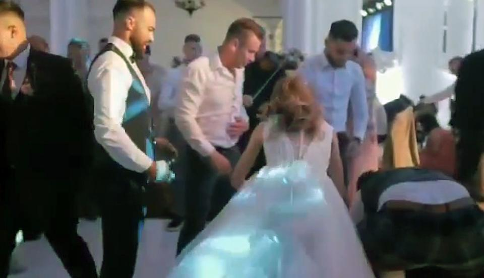 The bride is seen attending to her injured husband. Source: CEN/Australscope