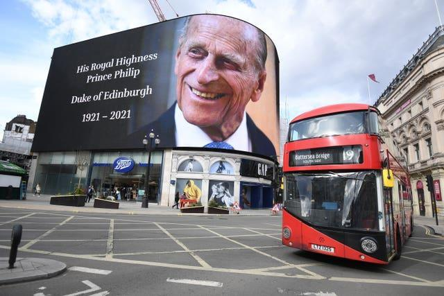 A tribute to the Duke of Edinburgh, which will be shown for 24 hours, on display at the Piccadilly Lights in central London