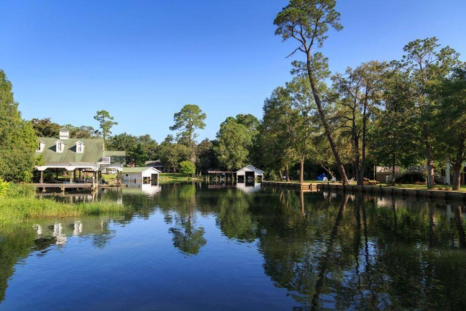 """<p><a href=""""https://www.townofmagnoliasprings.org/"""" rel=""""nofollow noopener"""" target=""""_blank"""" data-ylk=""""slk:Magnolia Springs"""" class=""""link rapid-noclick-resp"""">Magnolia Springs</a> is the definition of a small town named after mature magnolia trees that create a beautiful canopy along the Magnolia River. The Southern town has a <a href=""""https://www.southernliving.com/travel/alabama/magnolia-springs-al"""" rel=""""nofollow noopener"""" target=""""_blank"""" data-ylk=""""slk:rich history"""" class=""""link rapid-noclick-resp"""">rich history</a> dating back to the 1800s, when it was a settlement for the Spanish.</p>"""