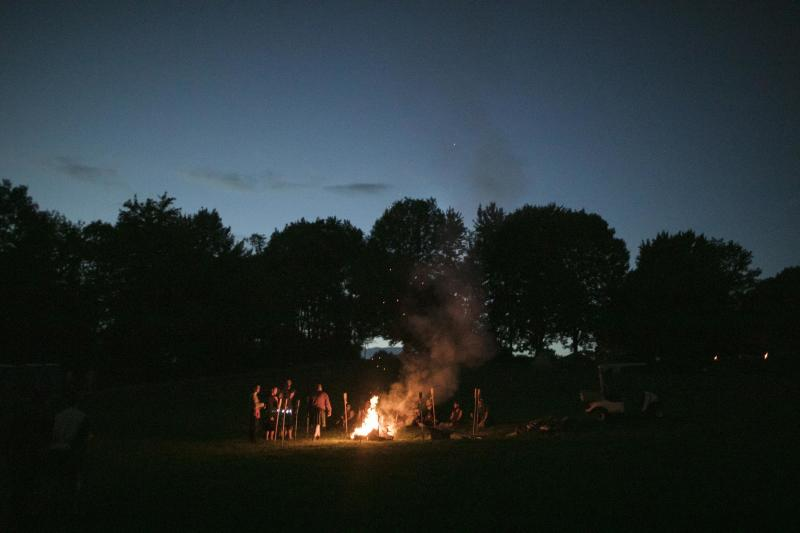 A bonfire rages after dark at Ragnarok.  (Maddie McGarvey for HuffPost)