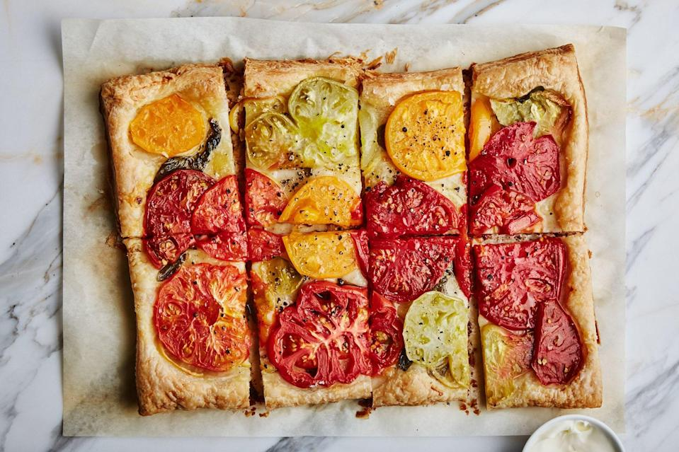 """Using <a href=""""https://www.epicurious.com/expert-advice/best-frozen-puff-pastry-article?mbid=synd_yahoo_rss"""" rel=""""nofollow noopener"""" target=""""_blank"""" data-ylk=""""slk:frozen puff pastry"""" class=""""link rapid-noclick-resp"""">frozen puff pastry</a> means this fancy tart is actually a super-easy appetizer for a cookout. <a href=""""https://www.epicurious.com/recipes/food/views/tomato-lemon-tart?mbid=synd_yahoo_rss"""" rel=""""nofollow noopener"""" target=""""_blank"""" data-ylk=""""slk:See recipe."""" class=""""link rapid-noclick-resp"""">See recipe.</a>"""