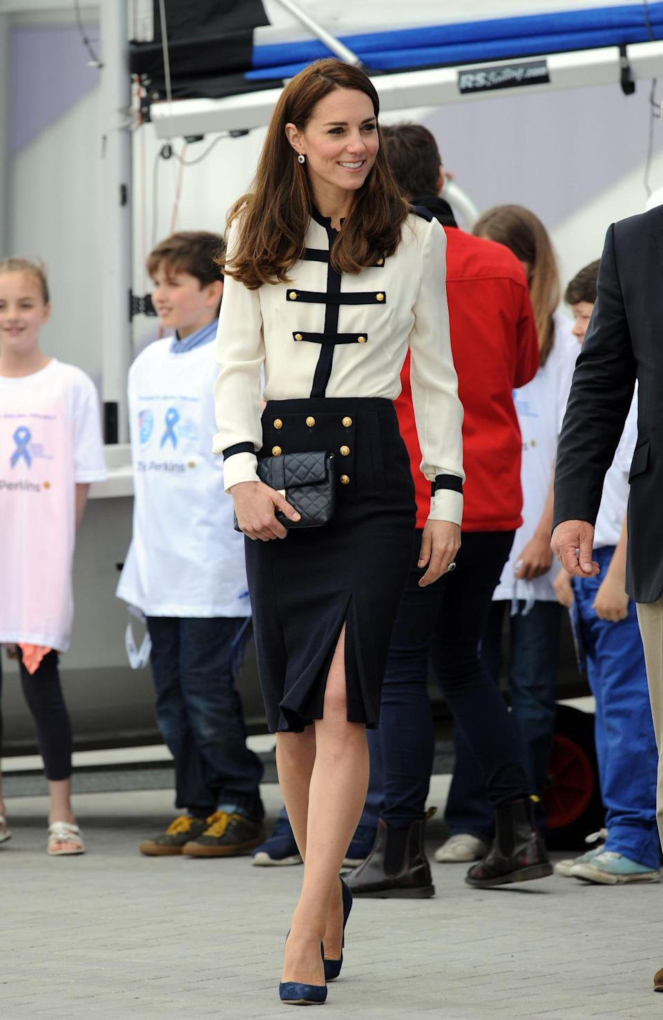 <p>Kate's visit to Portsmouth saw her in a military-inspired Alexander McQueen blouse and slitted skirt. Navy Rupert Sanderson heels and a black quilted bag by Jaeger topped off her suave look.</p><p><i>[Photo: PA]</i></p>
