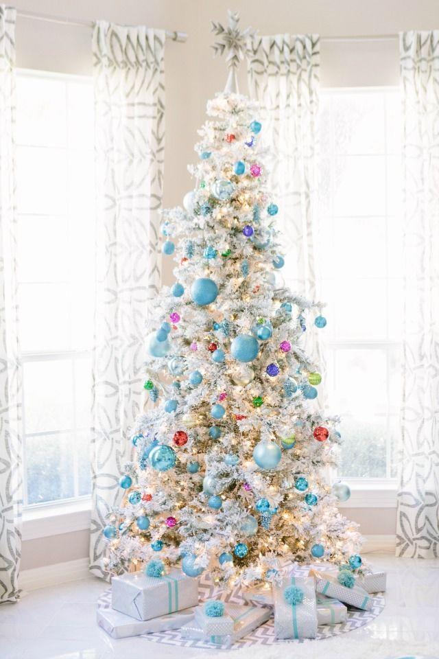 """<p>Stick to jewel tones for a Christmas tree look that's light, bright, and vibrant. </p><p><strong><em>Get the tutorial at <a href=""""https://designimprovised.com/2014/11/our-holiday-living-room-and-giveaway.html"""" rel=""""nofollow noopener"""" target=""""_blank"""" data-ylk=""""slk:Design Improvised"""" class=""""link rapid-noclick-resp"""">Design Improvised</a>. </em></strong></p><p><a class=""""link rapid-noclick-resp"""" href=""""https://www.amazon.com/32ct-Shatterproof-4-Finish-Christmas-Ornaments/dp/B017KOMDPS?tag=syn-yahoo-20&ascsubtag=%5Bartid%7C10070.g.2025%5Bsrc%7Cyahoo-us"""" rel=""""nofollow noopener"""" target=""""_blank"""" data-ylk=""""slk:SHOP BLUE ORNAMENTS"""">SHOP BLUE ORNAMENTS</a></p>"""