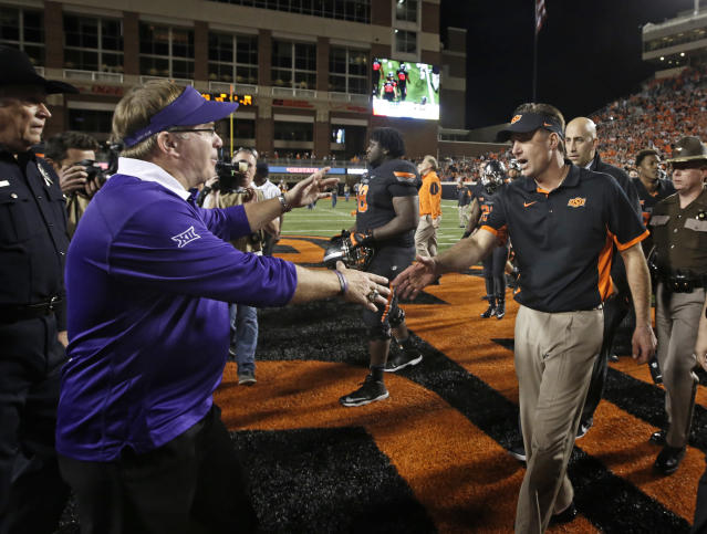 TCU's Gary Patterson and Oklahoma State's Mike Gundy have a marquee matchup on Saturday. (Getty)
