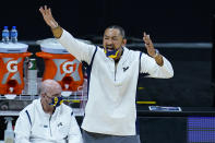 Michigan head coach Juwan Howard questions a call in the second half of an NCAA college basketball game against Maryland at the Big Ten Conference tournament in Indianapolis, Friday, March 12, 2021. Howard was later ejected from the game. (AP Photo/Michael Conroy)