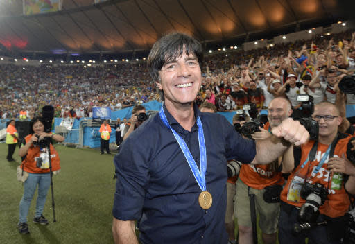 FILE - In this July 13, 2014 file photo Germany's head coach Joachim Loew celebrates after the World Cup final soccer match between Germany and Argentina at the Maracana Stadium in Rio de Janeiro, Brazil. Germany coach Joachim Loew is brimming with confidence just over three weeks before what he calls the countrys golden generation begins its World Cup defense against Mexico. (AP Photo/Martin Meissner, file)