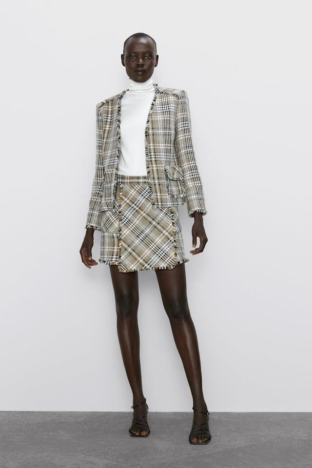 """<p><strong>The look:</strong> <a href=""""https://www.popsugar.com/buy/Tweed-Mini-Skirt-508627?p_name=Tweed%20Mini%20Skirt&retailer=zara.com&pid=508627&price=50&evar1=fab%3Aus&evar9=38443987&evar98=https%3A%2F%2Fwww.popsugar.com%2Ffashion%2Fphoto-gallery%2F38443987%2Fimage%2F42278799%2FCher-From-Clueless&list1=shopping%2Cfall%20fashion%2Challoween%2Czara%2Challoween%20costumes%2Cdiy%20costumes%2Ceasy%20costumes&prop13=mobile&pdata=1"""" rel=""""nofollow"""" data-shoppable-link=""""1"""" target=""""_blank"""" class=""""ga-track"""" data-ga-category=""""Related"""" data-ga-label=""""https://www.zara.com/us/en/tweed-mini-skirt-p08213117.html?v1=24603648&amp;v2=1281622"""" data-ga-action=""""In-Line Links"""">Tweed Mini Skirt</a> ($50) and <a href=""""https://www.popsugar.com/buy/Frayed-Plaid-Blazer-508628?p_name=Frayed%20Plaid%20Blazer&retailer=zara.com&pid=508628&price=90&evar1=fab%3Aus&evar9=38443987&evar98=https%3A%2F%2Fwww.popsugar.com%2Ffashion%2Fphoto-gallery%2F38443987%2Fimage%2F42278799%2FCher-From-Clueless&list1=shopping%2Cfall%20fashion%2Challoween%2Czara%2Challoween%20costumes%2Cdiy%20costumes%2Ceasy%20costumes&prop13=mobile&pdata=1"""" rel=""""nofollow"""" data-shoppable-link=""""1"""" target=""""_blank"""" class=""""ga-track"""" data-ga-category=""""Related"""" data-ga-label=""""https://www.zara.com/us/en/frayed-plaid-blazer-p08270117.html?v1=23941723&amp;v2=1281622"""" data-ga-action=""""In-Line Links"""">Frayed Plaid Blazer</a> ($90)<br> <strong>Pair it with:</strong> A white button-down, knee-high socks and heels, and an old-school cell phone glued to your ear</p>"""
