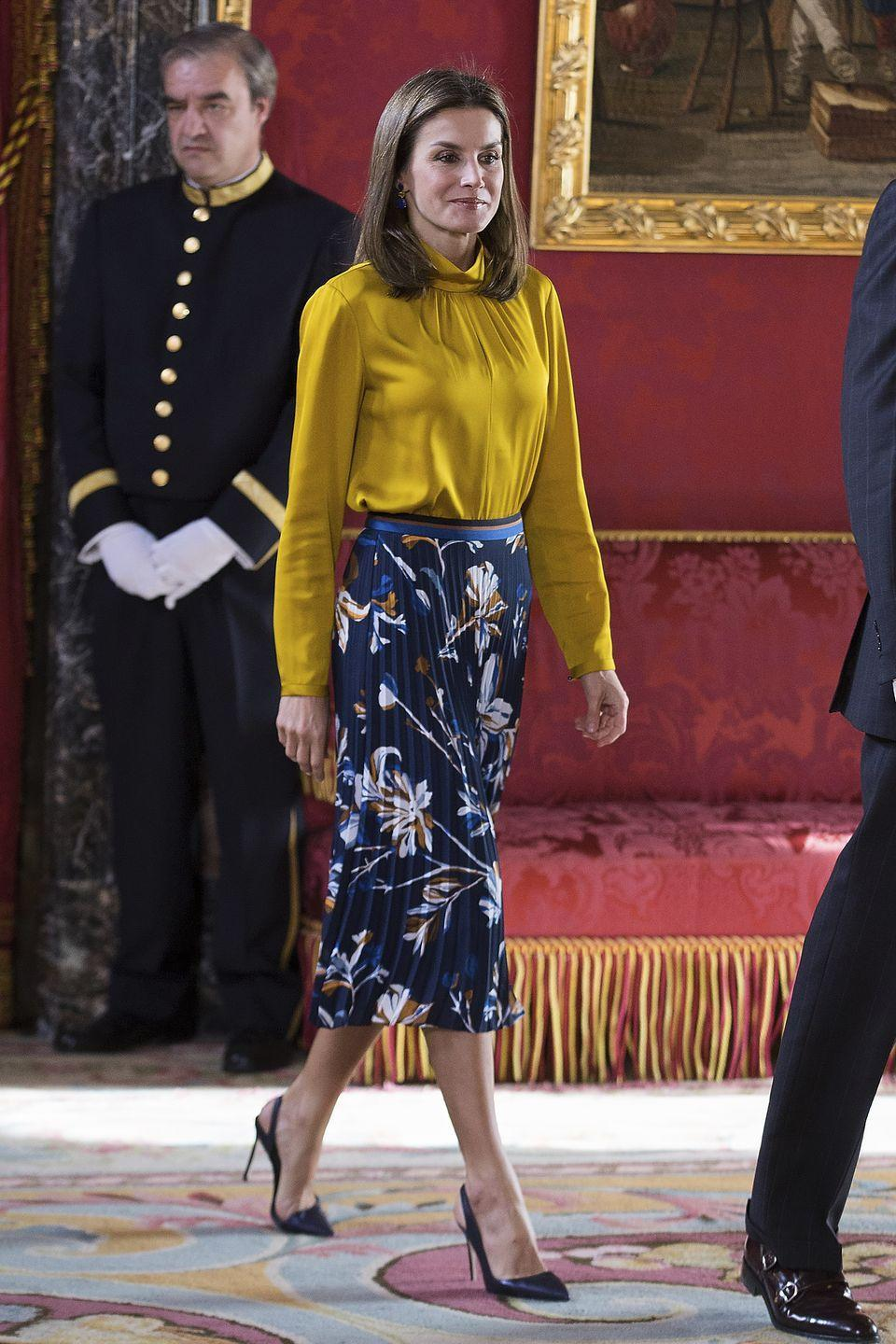 <p>Letizia wore a yellow blouse with a floral-printed skirt while receiving Palestinian President Mahmoud Abbas at the Royal Palace in Madrid. </p>