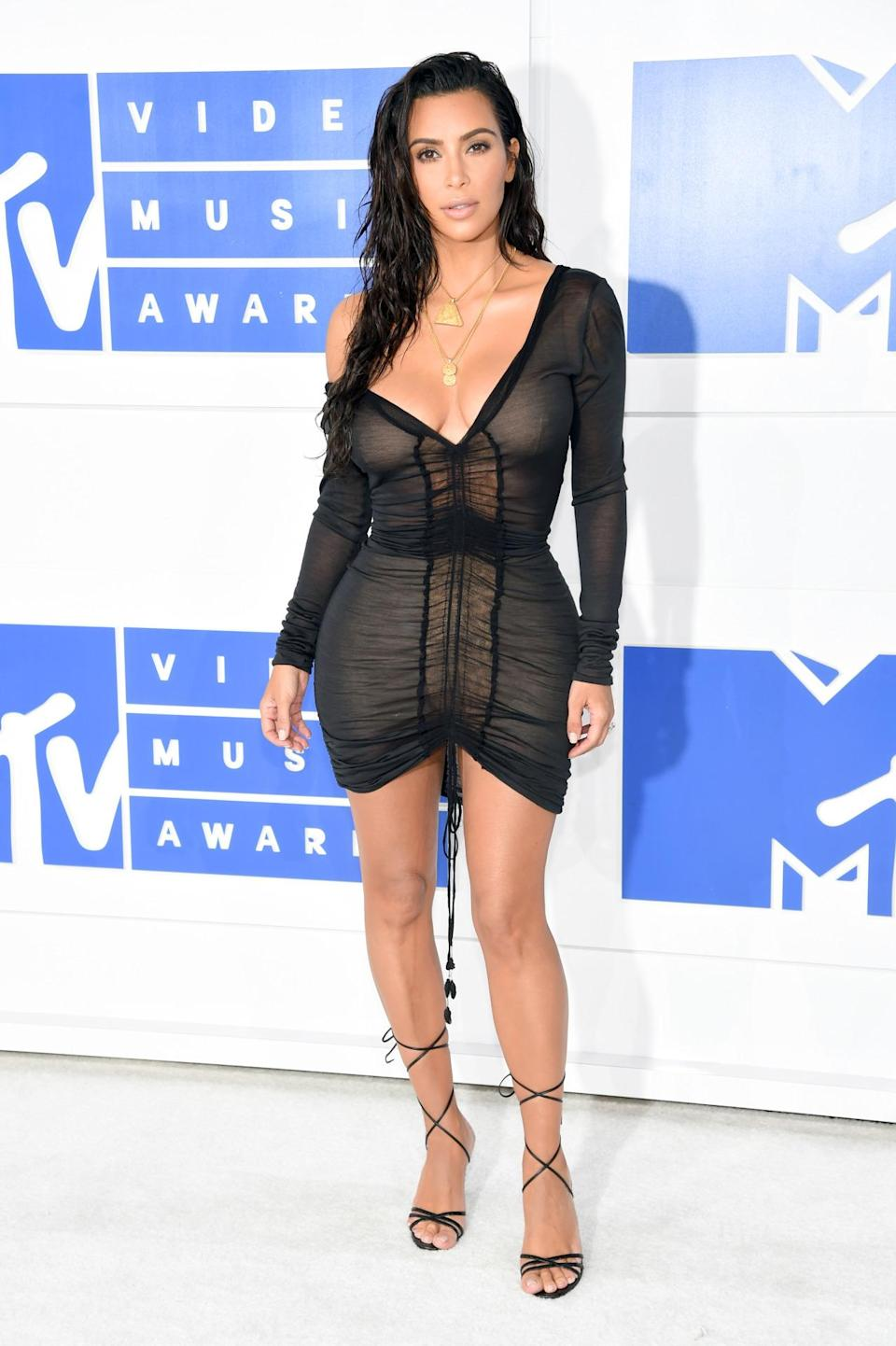 """<p>Kim Kardashian just couldn't decide what to wear, so she asked her Twitter followers to help. She asked 47.6 million fans whether she should go with a """"casual chill look"""" or a """"dressy sexy look,"""" and 52 percent voted for the latter. With that vote of confidence, the reality star selected a cotton minidress with ruching detail in the front and one shoulder purposefully pulled down. She wore lace-up heels and styled her hair in a fresh-out-of-the-shower kind of way. (<i>Photo: Getty Images)</i><br></p>"""