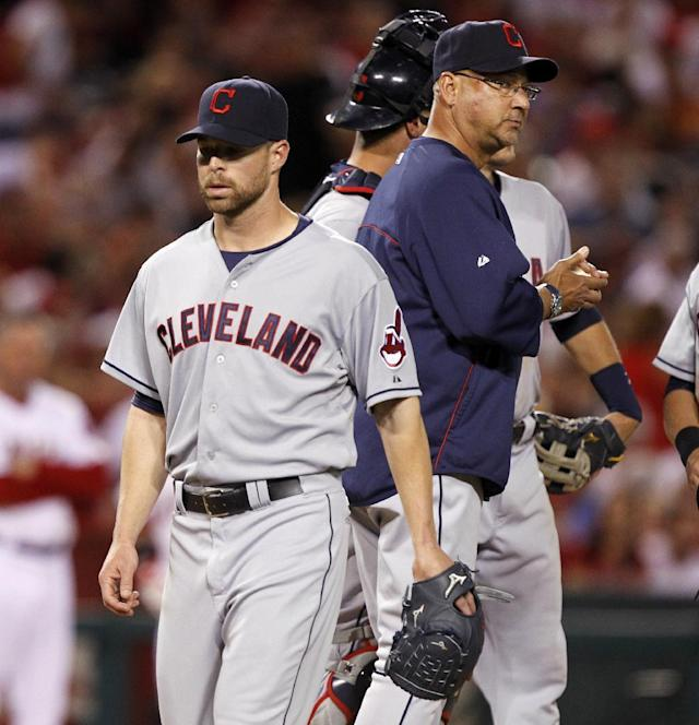 Cleveland Indians manager Terry Francona, right, pulls starting pitcher Corey Kluber, left, out in the fifth inning of a baseball game against the Los Angeles Angels on Tuesday, April 29, 2014, in Anaheim, Calif. (AP Photo/Alex Gallardo)