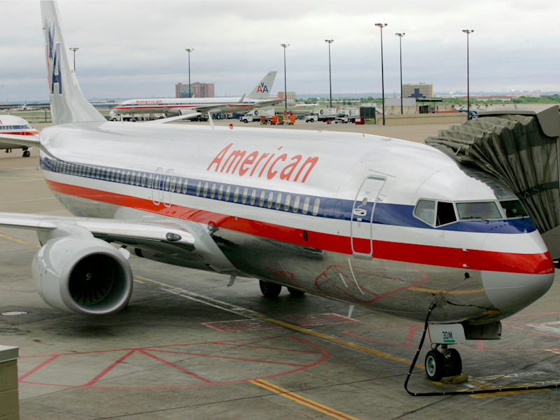 an american airlines passenger tore off his shirt and aggressively