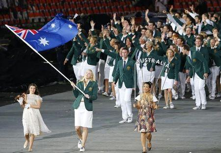 Australia's flag bearer Lauren Jackson holds the national flag as she leads the contingent in the athletes parade during the opening ceremony of the London 2012 Olympic Games at the Olympic Stadium July 27, 2012. REUTERS/Mike Blake