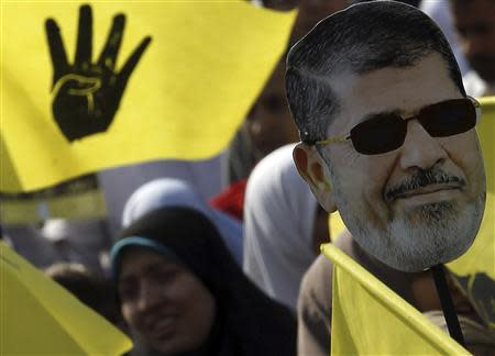 A supporter of ousted Egyptian President Mursi takes part in a protest in Cairo