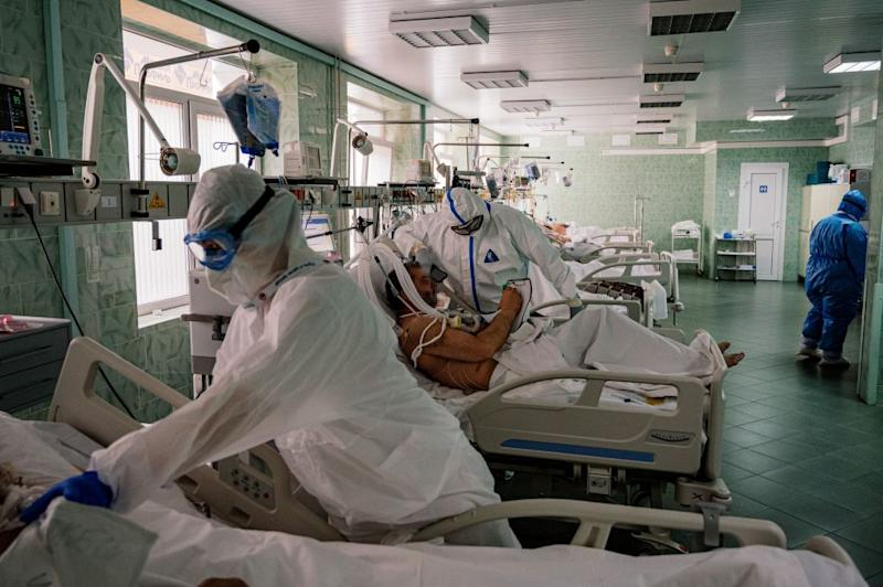 Russian doctors wearing personal protective equipment work in the intensive care unit for the COVID-19 coronavirus patients. Source: Getty