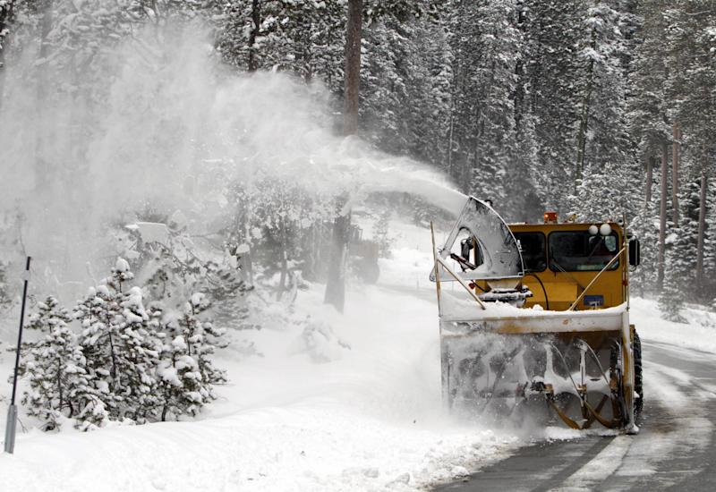 A snow blower clears a road after an overnight storm dropped several inches of snow near Echo Summit Calif., Tuesday, Feb. 28, 2012.  Despite recent storms which brought much needed snow to the Sierra Nevada, the California Department of Water Resources snow survey showed the snow pack to be 17.7 inches deep with a water content of 3.9 inches_ which is only 16 percent of normal for this location at this time of the year. (AP Photo/Rich Pedroncelli)