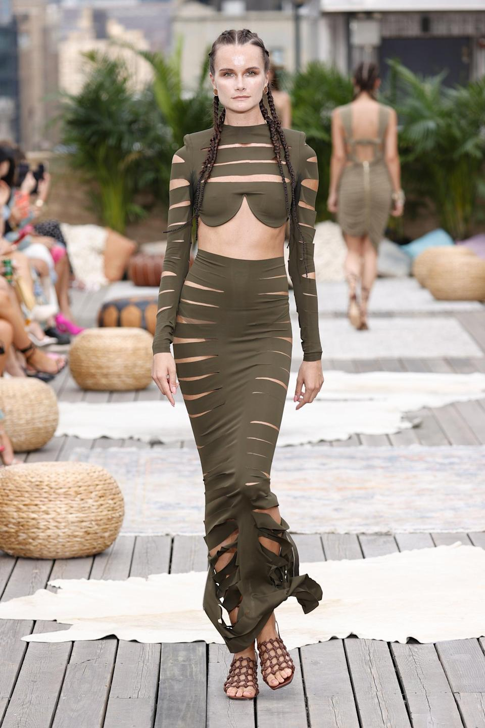 <p>Tell me you can't picture Chloé Bailey in this green olive Bronx and Banco two-piece set? With its midriff baring top and revealing cutouts on each piece, it's bold, sexy, and fashion-forward.</p>