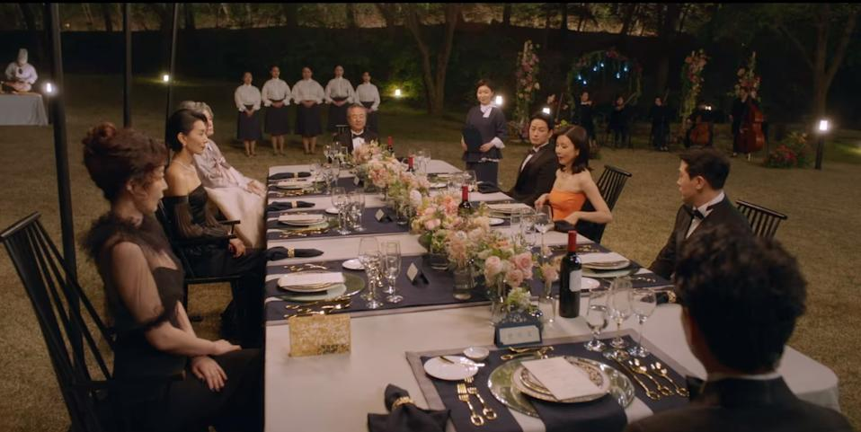 The aristocratic Han family sit down to an extravagant lawn dinner on their vast estate in Mine