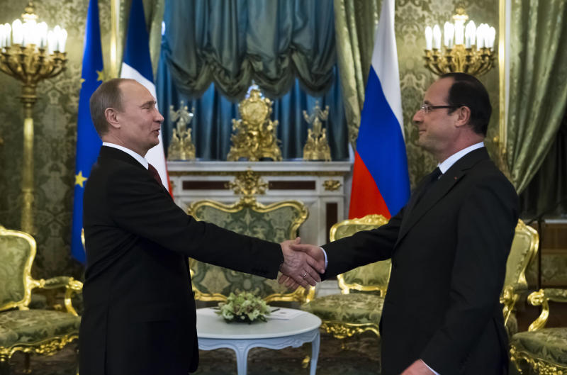 RETRANSMITTING FOR IMPROVE QUALITY France's President Francois Hollande, right, and Russian President Vladimir Putin shakes hands prior their talks in Moscow's Kremlin, Russia, on Thursday, Feb. 28, 2013. Hollande said Thursday that he hopes to discuss political transition in war-torn Syria with Russian President Vladimir Putin, whose stance on Syria is crucial to hopes for a peace settlement. Speaking ahead of this meeting with Putin at the Kremlin on Thursday afternoon, Hollande told the Ekho Moskvy radio station that Putin's position on Syria can determine how soon peace will come to Syria. (AP Photo/Alexander Zemlianichenko, pool)