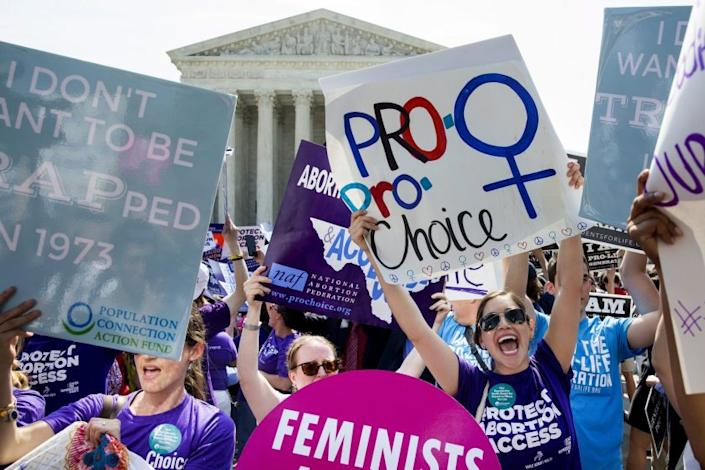 """Abortion rights activists celebrated the 2016 ruling overturning a Texas abortion restriction. It set the precedent for Monday's 5-4 vote striking down a copycat Louisiana law. <span class=""""copyright"""">(Michael Reynolds / European Pressphoto Agency)</span>"""