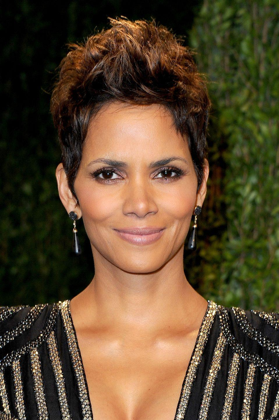 """<p>Actress <strong>Halle Berry </strong>is one of the first to rock a killer pixie cut. And honestly, her practically-perfect short hair will forever be loved. For easy, fool-proof styling, invest in a 1/2 inch <a href=""""https://www.goodhousekeeping.com/beauty-products/hair-styling-tool-reviews/g29022538/best-curling-wands/"""" rel=""""nofollow noopener"""" target=""""_blank"""" data-ylk=""""slk:curling wand"""" class=""""link rapid-noclick-resp"""">curling wand</a> to add texture to your short 'do. </p><p><a class=""""link rapid-noclick-resp"""" href=""""https://www.amazon.com/dp/B003F2T0M4?tag=syn-yahoo-20&ascsubtag=%5Bartid%7C10055.g.35472268%5Bsrc%7Cyahoo-us"""" rel=""""nofollow noopener"""" target=""""_blank"""" data-ylk=""""slk:SHOP CURLING WAND"""">SHOP CURLING WAND</a></p>"""