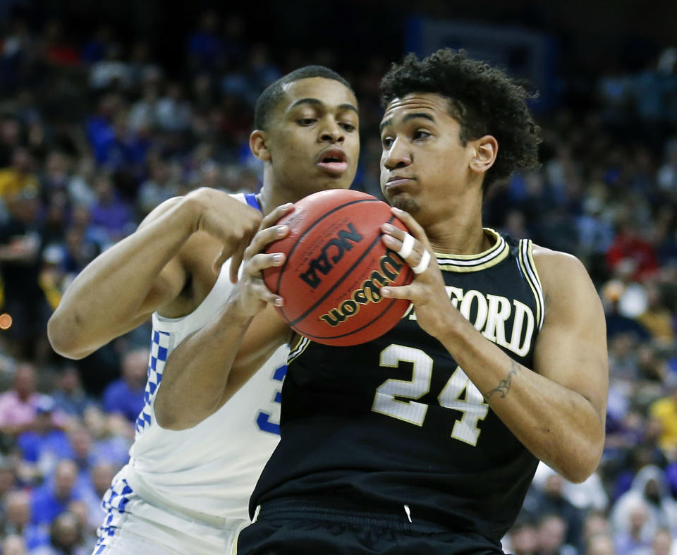 <p>Wofford forward Keve Aluma (24) looks for a path to the basket against Kentucky's Keldon Johnson during the first half of a second-round game in the NCAA men's college basketball tournament in Jacksonville, Fla., Saturday, March 23, 2019. (AP Photo/Stephen B. Morton) </p>