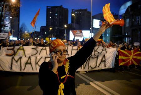 Protesters shout slogans during demonstrations against an agreement that would ensure the wider official use of the Albanian language, in Skopje