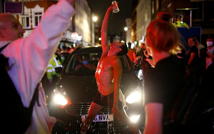 The streets of Soho took on a carnival atmosphere - Reuters